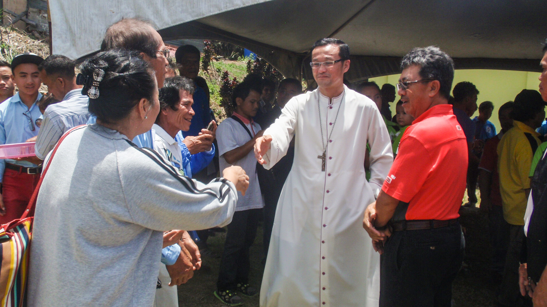 Abp Wong gets to meet the parishioners during the parish feast day.