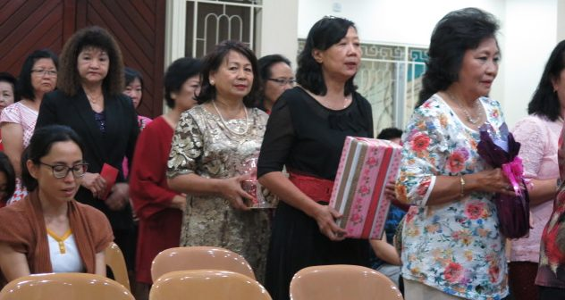 Members line up during the Presentation of Gifts, Blessed Sacrament Chapel, Karamunsing.