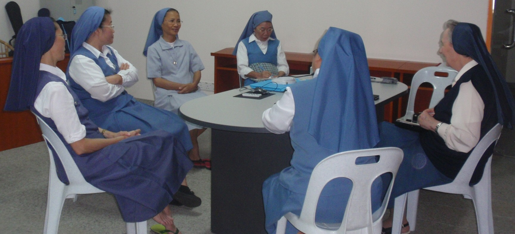 The sisters listen to one another during a sharing session with Sr Anna Maria Parenzan (R) with Sr Yolanda Dionisio as her interpreter (back to camera).