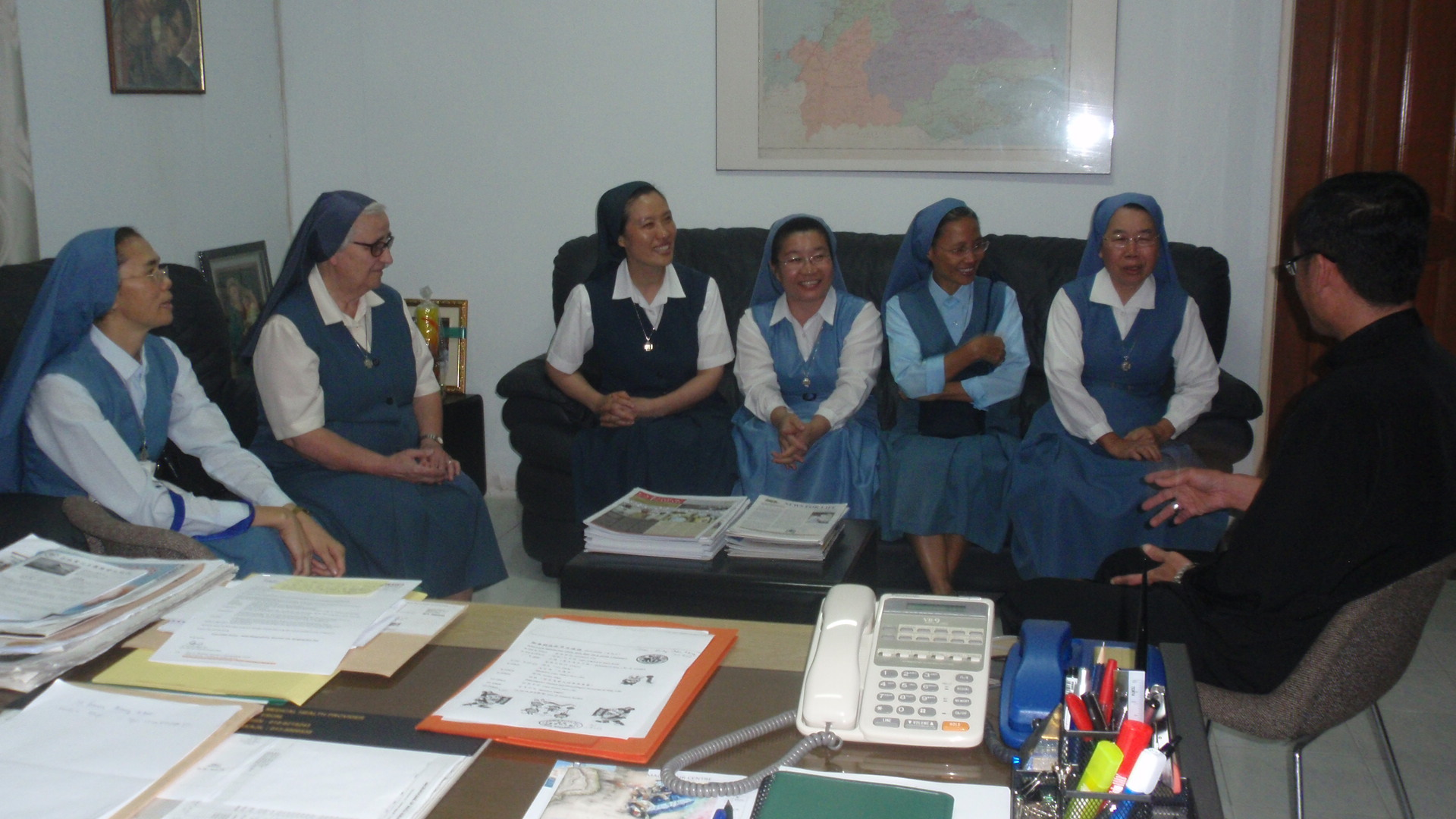 The local sisters accompany Sr Samuela (2nd L) and Sr Lucia (4th from R) on their courtesy call on Abp Wong at his office Feb 19.