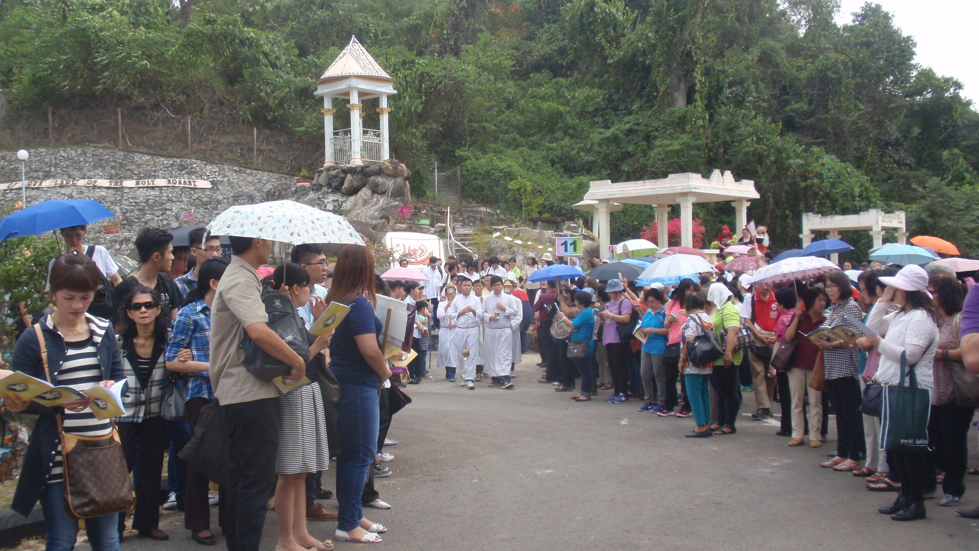 The pilgrims make their way slowly from the grotto to the Holy Rosary Holy Door in Limbahau March 13.
