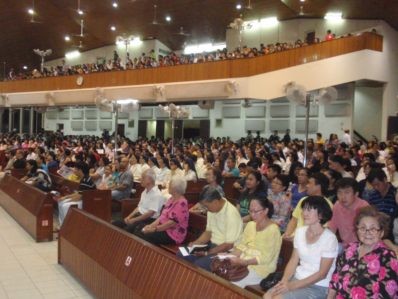 A section of the congregation waiting for Mass to begin.