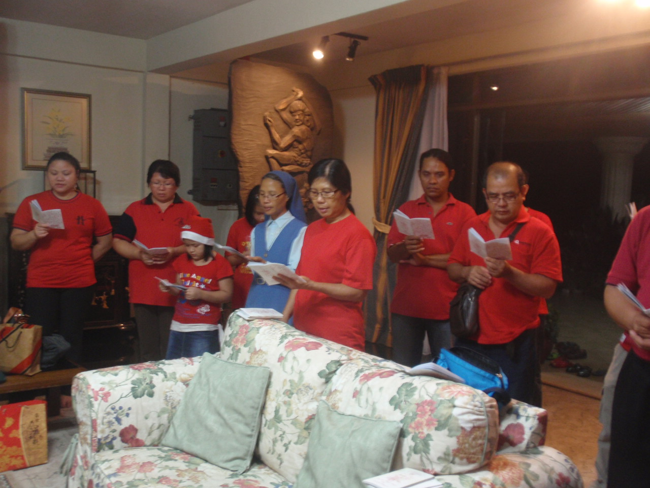 A section of the carollers singing in the home of one of the families visited.