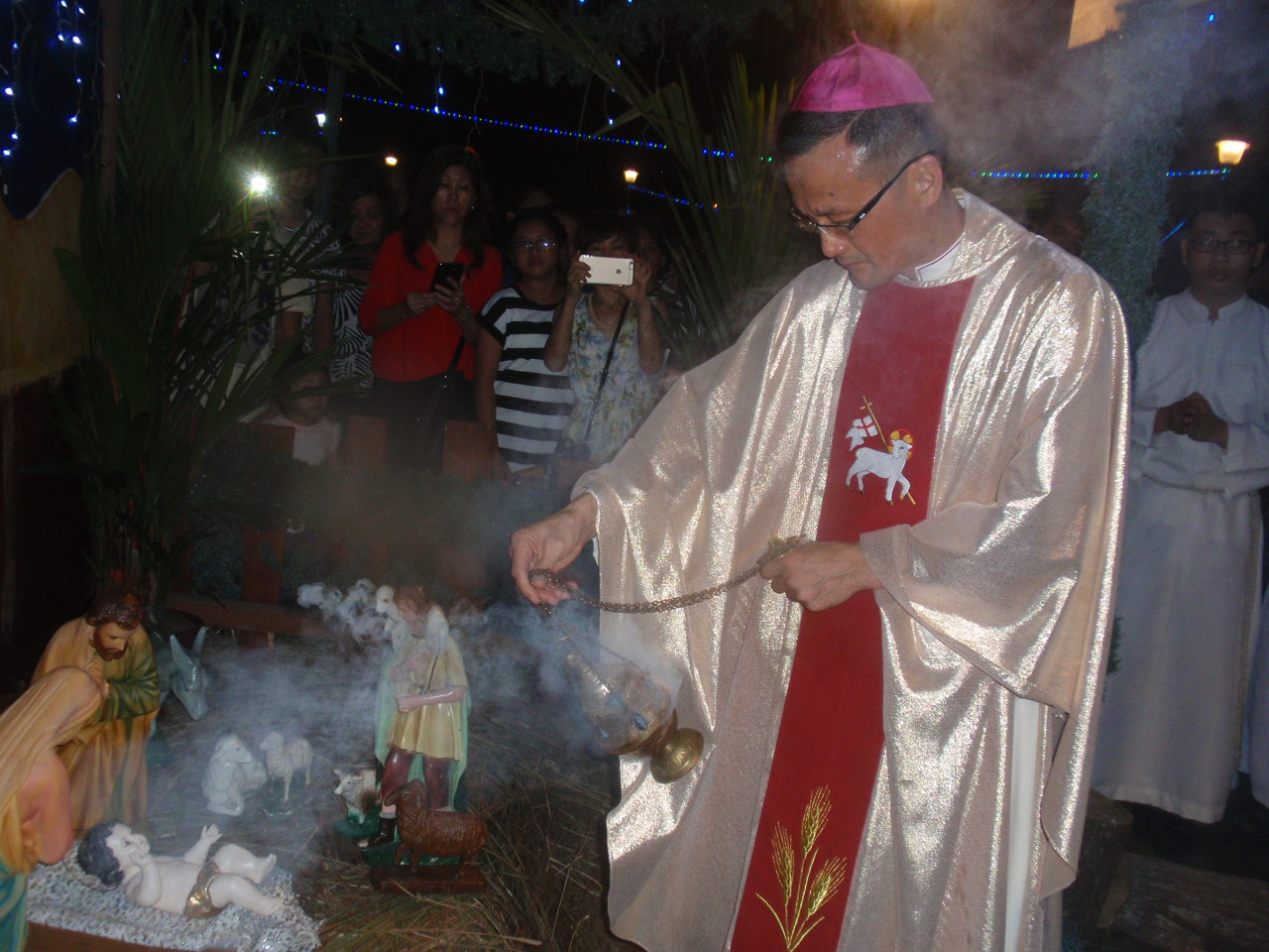 Abp Wong incenses the manger at the rite of blessing.