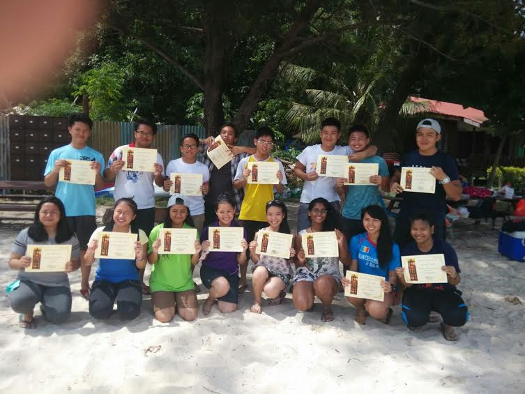 The students pose with their certificates.