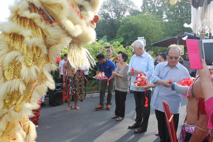 Br Yvon cuts the ribbon to open the carnival.