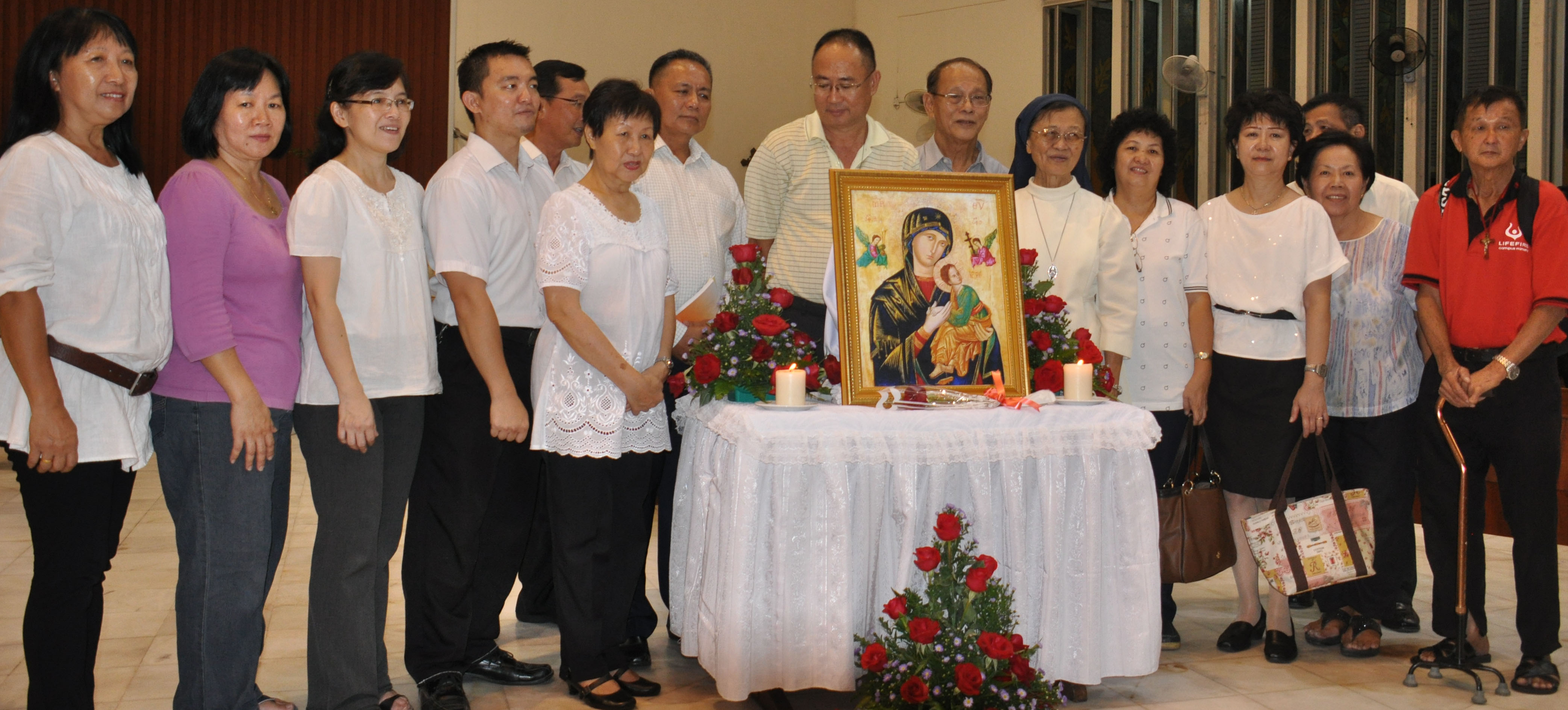 The organising team pose with the icon after the Mass.