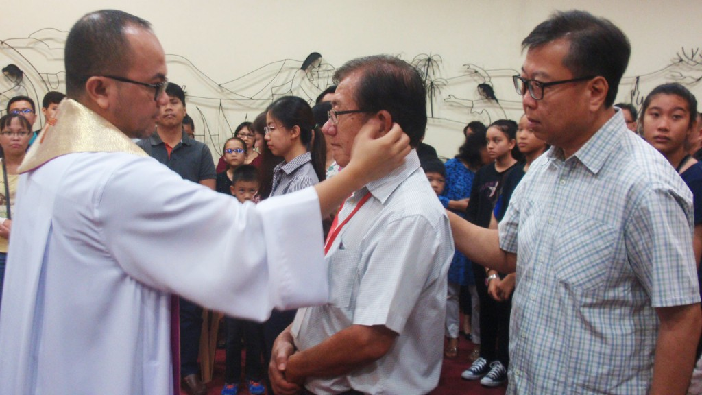 Fr Rhobby Mojolou anoints the ear of one of the elect during the preparation rites at the Sacred Heart Cathedral Chapel Mar 26.