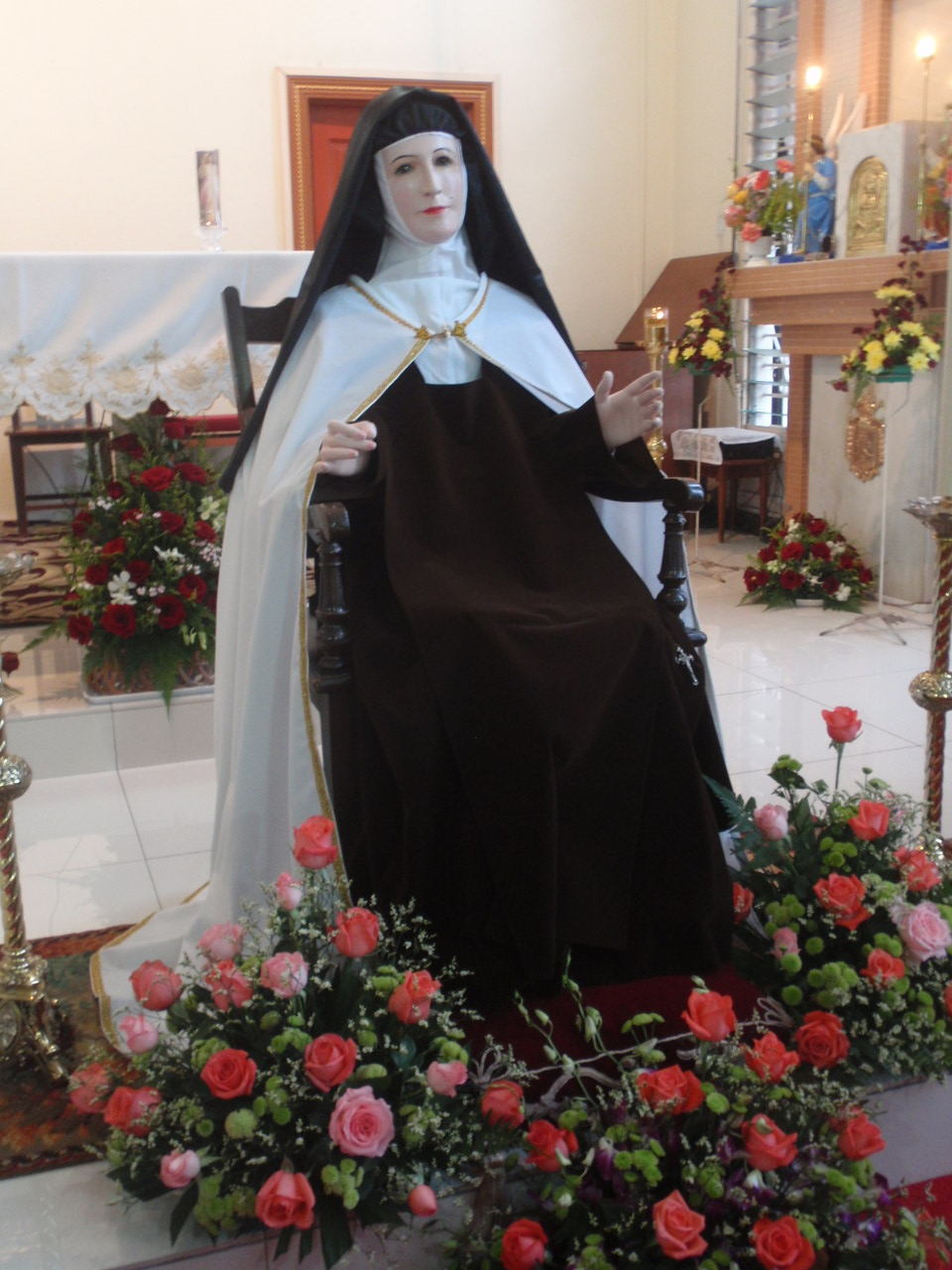 A seated Teresa of Avila depicting her teaching authority on contemplative prayer.