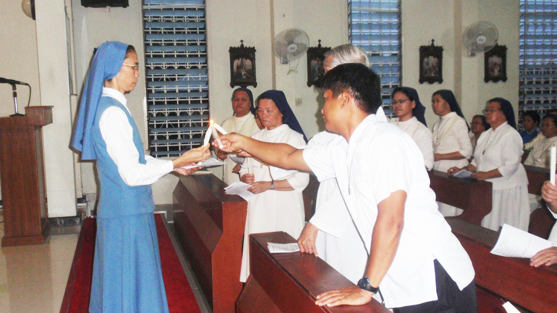 Sr Christine shares the light with the Brothers.